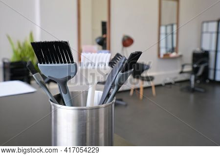 Hair Dye Brushes In A Hairdressing Salon. Hair Coloring Tools Set. Professional Instrument For Hair