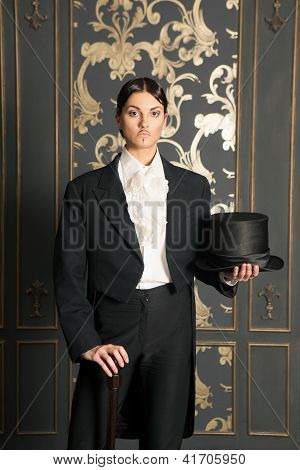 Woman In A Men's Classic Costume Holding A Cylinder