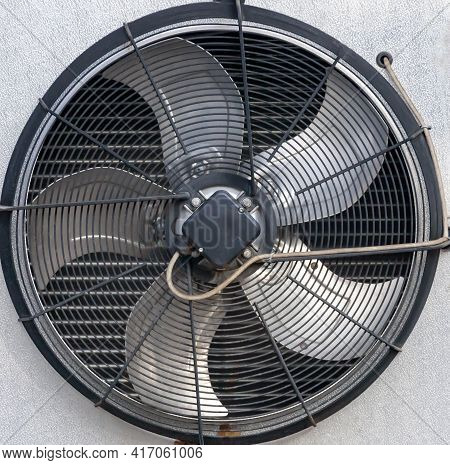 Fan Blades, Grille, And The Outer Part Of The Industrial Air Conditioner Housing. Background With Ro