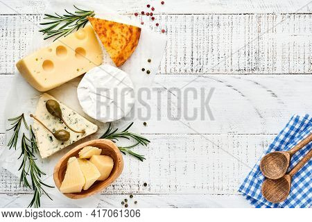 Set Or Assortment Cheeses. Suluguni With Spice, Camembert, Blue Cheese, Parmesan, Maasdam, Brie Chee