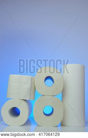 Toilet Paper And Napkins. Hygiene And Cleanliness. Rolls Of Toilet Paper And Napkins On Blue Backgro