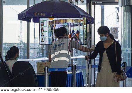 Bangkok, Thailand - April 11, 2021 : Airport Terminal Officers Use Thermal Scanner To Checking Passe