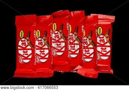 Lviv, Ukraine - April 08, 2021: Kitkat Mini Chocolate Bar In A Wrapper On A Black Background
