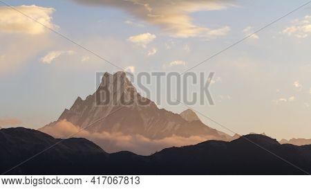 Morning In Foggy Mountains, The Sunbeams Break Through The Clouds And Illuminate The Mountain.