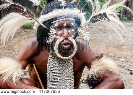 Wamena, Indonesia - January 9, 2010: The Head Of The Dani Tribe In A Traditional Dress In Dugum Dani