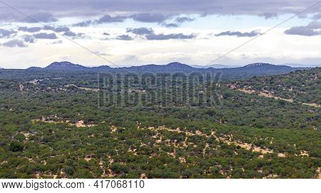 Green Hills Of Africa Or The Savanna Landscape In The River Valley. View Of The Sky Landscape And Th