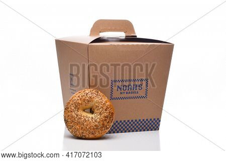 IRVINE, CALIFORNIA - 8 JUNE 2020: An Everything Bagel with a Noahs NY Bagels take out carrier.