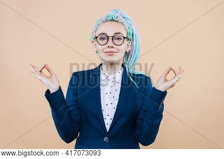 Business Lady With Colored Dreadlocks Is Meditating, Relaxing. Young Woman Girl In Suit, Glasses Kee