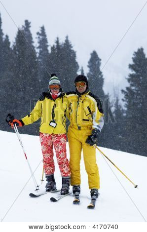Couple Skiers Under Snowfall