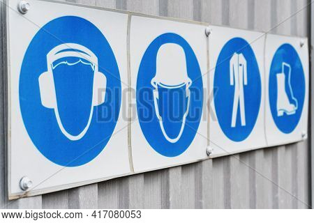 Safety Signs And Posters Of Personal Protective Equipment At Work