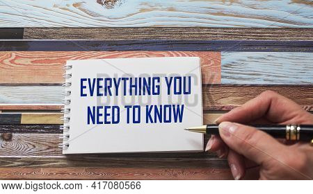 Everything You Need To Know. Motivational Quote Is Written By A Stiff Hand On A Notebook. Striped Ba