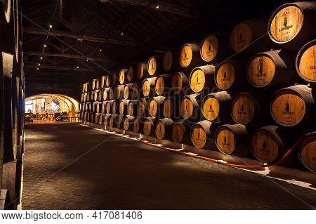 Porto, Portugal: Historical Corridor Inside Winery Sandeman, With Wooden Barrel, It Making Porto Win