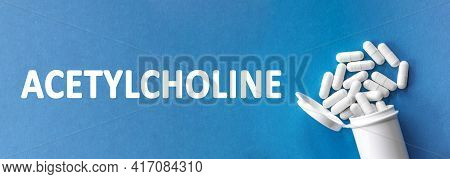 The Word Acetylcholine Is Written Near Pills On A Light Blue Background. Medical, Health And Happine