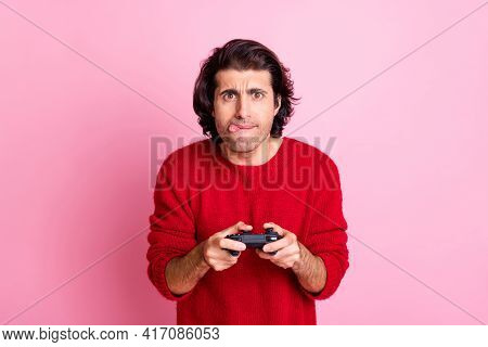 Photo Portrait Of Immersed Man Sticking Finger Out Playing Videogame With Controller Isolated On Pas