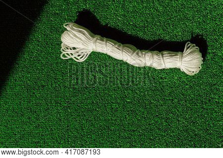 Nylon Rope Factory On Green Artificial Grass. Rope Rope In A Skein. Rope Skein Background