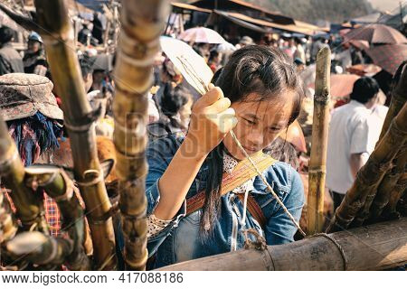 Bac Ha, Vietnam - April 4, 2016: Young Hmong Tribe Girl Make Traditional Crafts At Can Cau Saturday