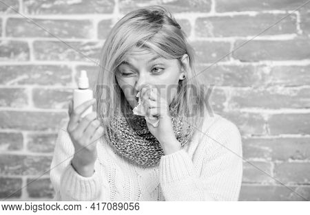 Clearing Up The Blockage. Pretty Girl With Runny Nose Holding Nasal Drops. Sick Woman Injecting Drop