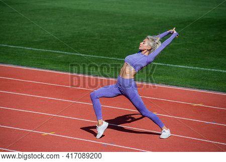Full Of Energy. Athletic Lady Warming Up On Stadium Running Track. Female Athlete Do Sport Workout