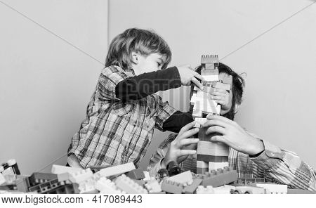 Childish Cheerful Dad And Funny Son. Dad Play Toys With Kid. Dad And Child Build Plastic Blocks. Hap