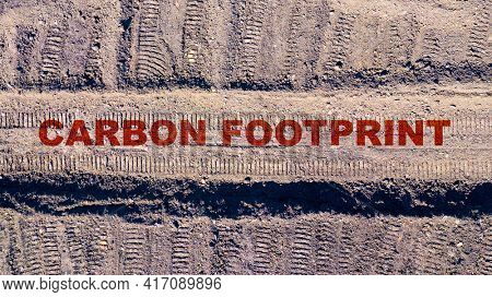 Aerial view to tracks in coal mine with text Carbon Footprint. Environment and climate change theme.