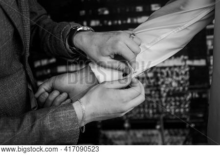 The Man Fastens The Cufflink On The Sleeve Of His Shirt. The Groom Fastens A Button On The Sleeve Of