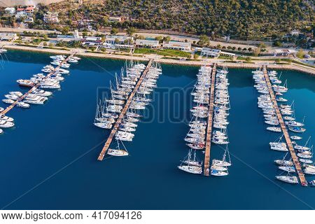 Aerial View Of City Marina Or Port With Yachts And Boats Docked On A Calm Warm Summer Morning.