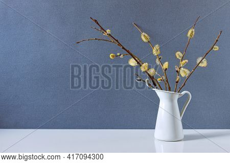 A Vase With Pussy Willow Branches On A White Table, Pussy Willow Buds Blossomed In Early Spring, For