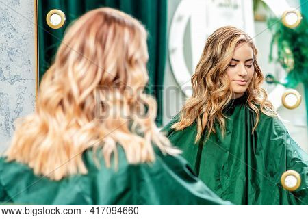 Hairstyle Of Young Woman In The Mirror At Beauty Salon, Beauty Concept.