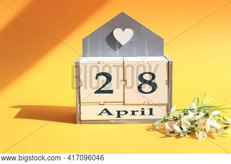 Calendar For April 28 : Cubes With The Number 28, The Name Of The Month Of April In English, A Bouqu