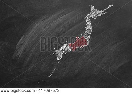 Country Map And Flag Of Japan Drawing With Chalk On A Blackboard. One Of A Large Series Of Maps And