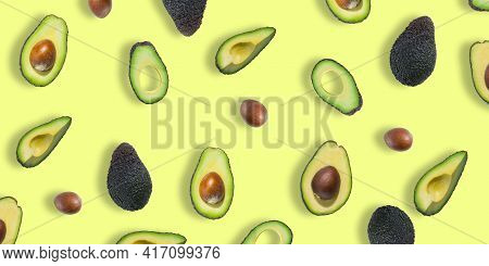 Pattern Of Fresh Ripe Green Avocados. Avocado Banner. Avocado Pieces And Halves Isolated On A Yellow