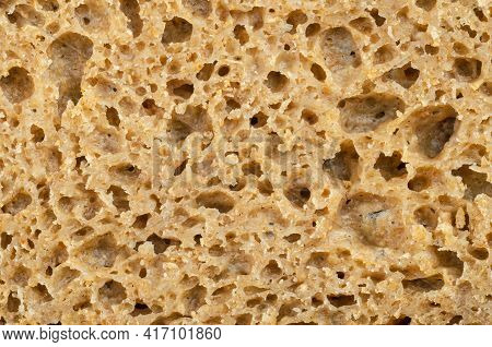 Surface Of A Fresh Cut Rye Bread, Close-up From Above. Brown Colored Sourdough Bread, A Mix Of Rye G