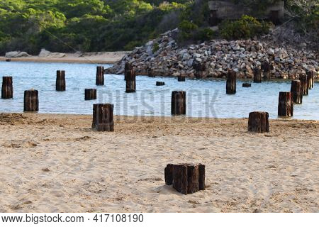 Rusty Old Remnant Bridge Base Struts Over Riverbank, Mossel Bay, South Africa