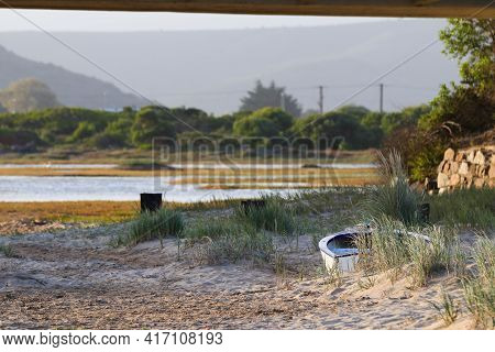 Small Boat Stranded On Sandy Coastal Riverbank, Mossel Bay, South Africa