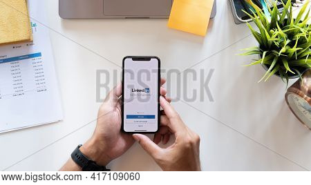 Chiang Mai, Thailand, Apr 15, 2021 : A Man Holds Apple Iphone Xs With Linkedin Application On The Sc