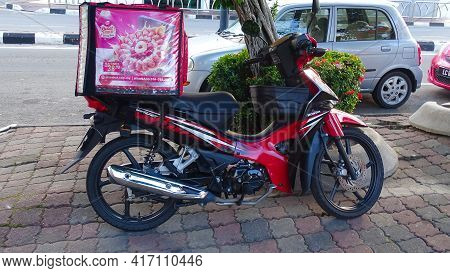 Labuan,malaysia-jan 26,2021:view Of Food Delivery Service Motorcycle At Labuan,malaysia. During The