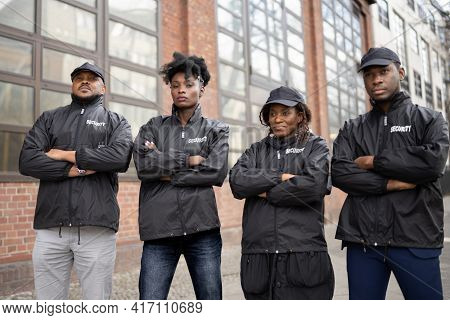 Group Of Security Staff At Event. African Bodyguard Officers