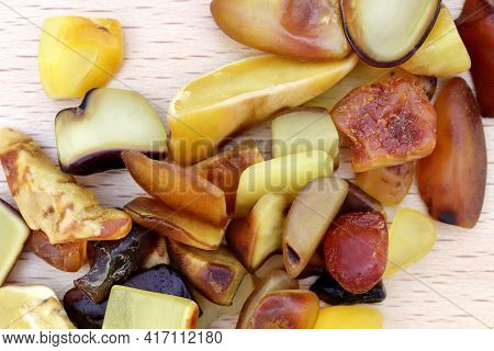 Amber Jewel Stones Heap Up Texture On Light Varnished Wood Background