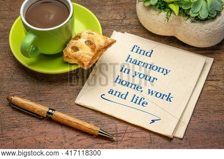 find harmony in your home, work and life - inspirational handwriting on a napkin with a cup of coffee, lifestyle and personal development concept