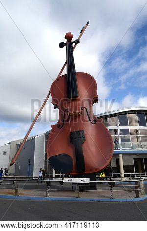 SYDNEY, NOVA SCOTIA - OCTOBER 10, 2011: A monument to the Celtic heritage of Cape Breton the worlds largest fiddle at the Sydney Marine Terminal.