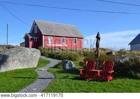 PEGGYS COVE, NOVA SCOTIA - OCTOBER 10, 2011: Old Red Schoolhouse, Peggy's Cove, Nova Scotia, Canada, landmark, landscape,