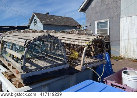PRINCE EDWARD ISLAND, CANADA - OCT 11, 2011: Lobster traps on the dock in Cavendish, Prince Edward Island.