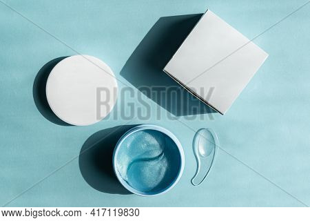 Hydrogel Cosmetic Eye Patches For Skin Care On Blue Pastel Background. Product For Skin Lifting, Ant