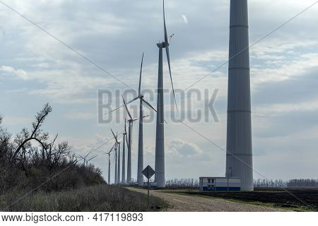A Group Of Wind Farms To Generate Electricity On A Beautiful Bright Day. Green Electricity.