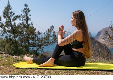 Young Woman With Long Hair, Fitness Instructor In Sportswear Leggings And Tops, Stretching Before Pi