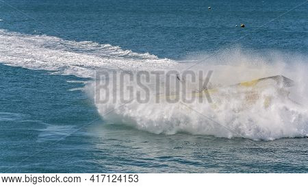 Airlie Beach, Queensland, Australia - April 2021: Water Sprays Over Tourists Having Fun In A Jet Boa