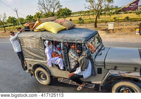 Jaipur, India - Jan 04, 2020: Happy Asian Indian Family Sitting In Car Talking And Smiling Happily A
