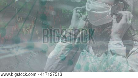Mid section of caucasian woman wearing a mask in the street. with a data background concept. digitally generate image