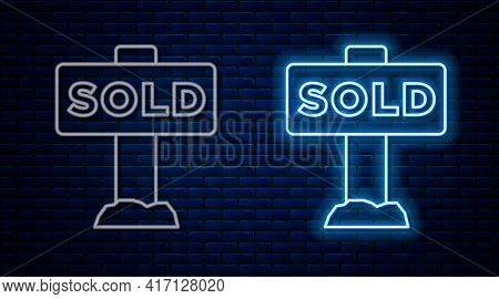Glowing Neon Line Hanging Sign With Text Sold Icon Isolated On Brick Wall Background. Sold Sticker.