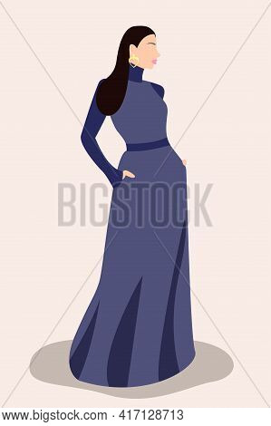 Portrait Of Standing Young Woman In A Long Blue Dress. Minimalist Boho Style Portrait For Contempora
